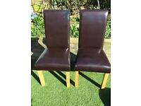 2 x faux leather dining chairs in need of refurbishment