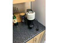 White Nespresso Vertuo Coffee Machine and some pods