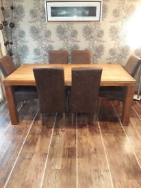 Large dinning table and six chairs
