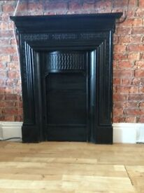 Black cast iron fireplace surround