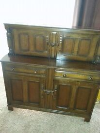 ERCOL COURT DRESSER/ CABINET WITH FREE DELIVERY.