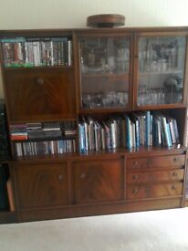 Vintage dark wood display unit with glass fronted cabinets and a pull down bar