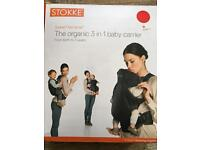 Brand new Stokke front and back baby carrier