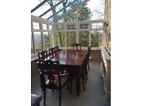 Quality dining table and eight chairs including two carvers