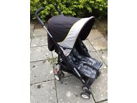 Mothercare very small/compact stroller. Fits in boot of Ka car.