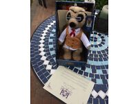 Yakov meerkat toy in box with certificates