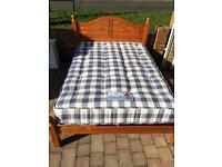 Solid pine double bed with clean mattress