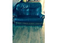 Two seater green leather sofa. Good condition. Collection only. 07504442239