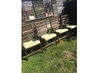 4 wooden reclining chairs with cushions