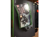 Xbox One X Brand new in box £450 new with two sealed games