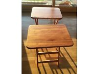Small wooden folding table.