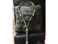 Yellow and black babolat tennis racket