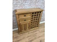 Oak 32 bottle wine with storage cupboard and drawers