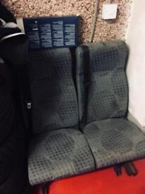 Transit seats with seat belts