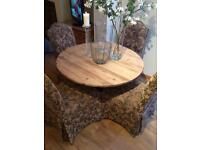 Antique scrubbed pine round table with six beautiful high backed chairs
