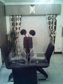 Glass dining room table and 4 z brown leather chairs