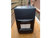 Calor gas heater and bottle.