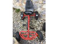 Red metal pedal go kart and trailer