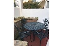 Beautiful cast iron garden table and chairs