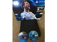 PS4 SLIM WITH 2 GAMES ON DISC