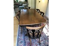 Ercol colonial refectory dining table and 6 fleur de lys chairs