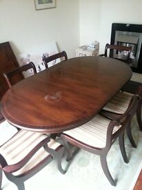 Large dining table and chairs, 6 chairs and extension centre. Dark mahogany veneer.