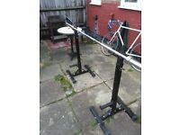 Barbell gym equipment: 122.5kg weights, bar, and bench