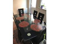 Luxury glass dining table and 6 leader chairs
