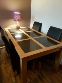 Used Dinning table and 4 faux leather chairs.