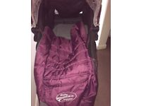City Mini Baby Jogger Purple. Comes with rain cover, foot muff and sheepskin lining.