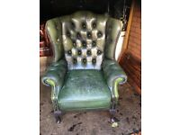 Distressed look leather chesterfield chair