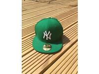 NY green cap