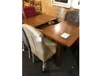 Dark solid wood extendable table and six new buttoned chairs
