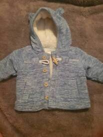 Next boys up to 1 month soft fluffy jacket