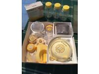 Madela Swing breast pump with extras