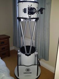 Meade Lightbridge 10 inchTruss Dobsonian telescope. Used only once and in immaculate condition.