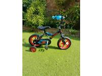 Childs bike with stabilisers. Urchin make. 16 inches to seat