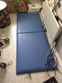 Padded wall panel and floor mats