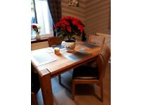 Dining table and 4 chairs 6ft by 3ft brand new condition