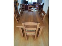 Dining Table and 8 matching chairs. Solid Oak M&S Hemsley range extending table
