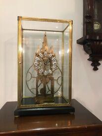 Cased skeleton clock. Full working order.