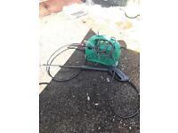 Small green pressure washer