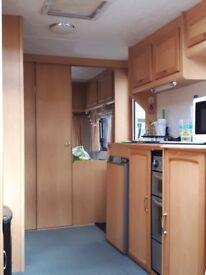 5 berth caravan fixed bunks in end bedroom. twin axle. Compass corona 630. yr 2003