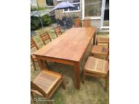 Modern large dining table and 8 matching chairs