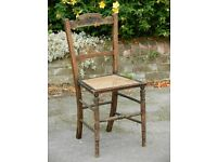 Vintage solid wooden chair with wicker seat