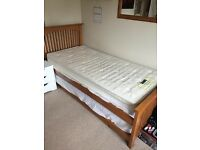 Trundle wooden guest bed