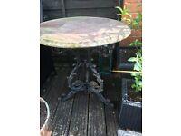 Iron based garden table