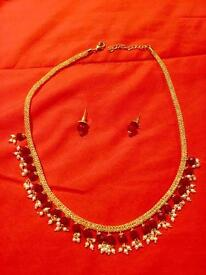 Red crystal necklace with earrings.