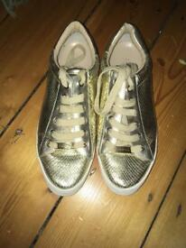 Gold Kurt Geiger Carvela trainers/pumps