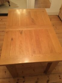 Solid Oak Dining Table. Extending.